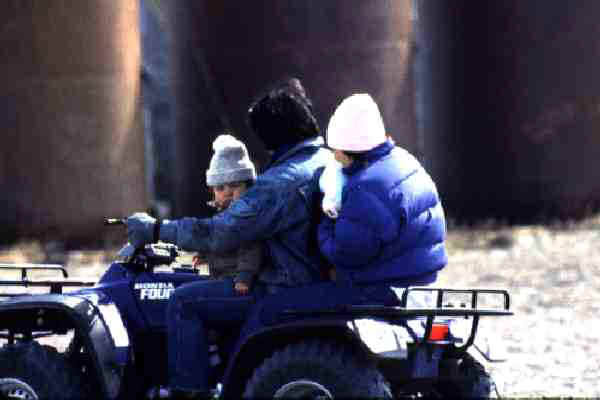 Inuit families traverse the village and island via 4-wheelers